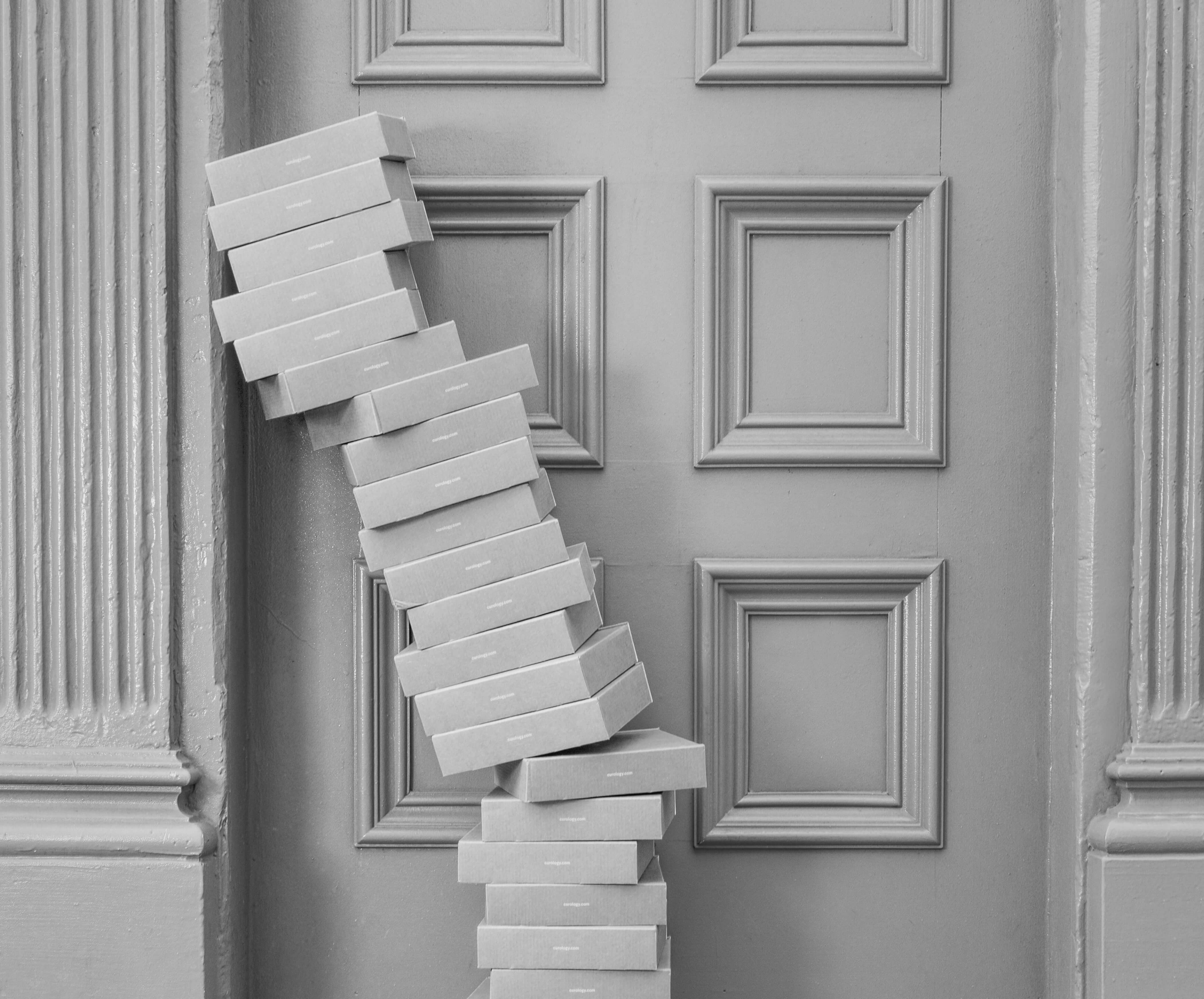 stacked boxes on a door way